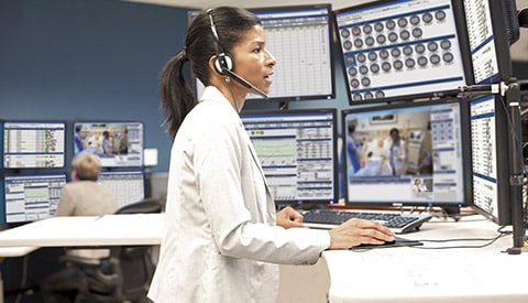 a clinician monitoring and assisting a patient over a phone call
