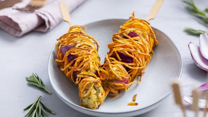 Crispy chicken skewers with spaghetti